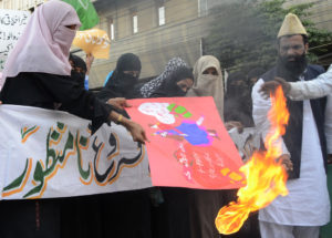 Supporters of Pakistani religious party Jamiat Ulema-e-Pakistan burn Valentines placards at rally to condemn Valentines Day celebrations in Karachi, Pakistan on Tuesday, Feb 14, 2012. (AP Photo/Shakil Adil)