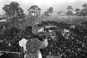 Pakistani People's Party leader (PPP), Benazir Bhutto, delivers a speech, 18 April 1986, few days after her release, in Rawalpindi. Born in 1953 in Karachi and eldest daughter of former Prime Minister of Pakistan Zulfikar Ali Bhutto, she studied at Harvard University. In 1979 her father is hanged and she becomes leader of Pakistan People's Party. Benazir Bhutto spends seven years in exile or under house arrest. In 1986 Bhutto returns to Pakistan and on April 1987 becomes Prime Minister of Pakistan. On December 2, 1988 Benazir Bhutto was sworn in as Prime Minister of Pakistan, becoming the first woman to head the government of an Islamic State. She was re-elected in 1993 but was dismissed three years later accused of corruption scandals concerning contracts awarded to Swiss companies during her regime. In 1996 Bhutto removed from government and lived in exile in UK. Her husband, Asif Ali Zardari, spent eight years in jail until he was released in November 2004.
