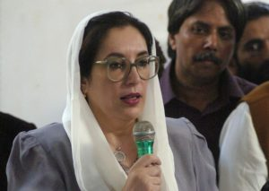 "Former Pakistani premier Benazir Bhutto addresses media representatives at a press conference in Karachi, 19 October 2007. Bhutto strongly condemned bomb attacks on her homecoming parade in Karachi, saying that her followers had made the ""ultimate sacrifice"" for democracy. Bhutto escape unhurt, a suicide bomber attack that killed at least 133 people in an attempt to assassinate her during a homecoming parade. AFP PHOTO/ASIF HASSAN"