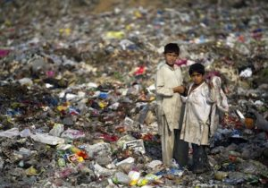 Pakistan scavenger boys collect recyclable items from garbage to a earn living for their families in Islamabad, Pakistan, Wednesday, June 12, 2013. The International Labor Organization (ILO) observes June 12 as the World Day Against Child Labor to highlight the plight of child laborers. (AP Photo/B.K. Bangash)